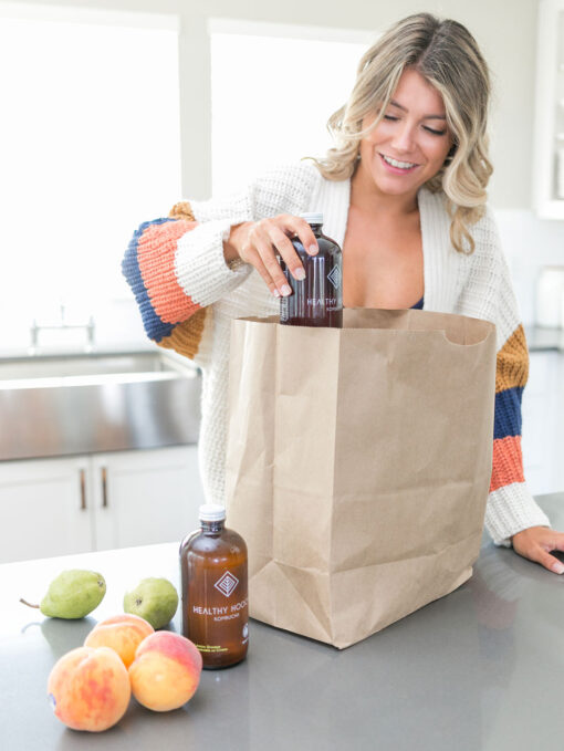 woman putting away her healthy groceries