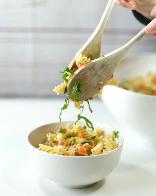 wooden spoons serving pasta salad