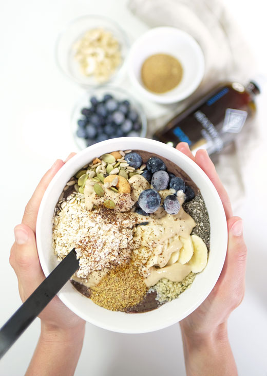 woman holding a smoothie bowl in her hands