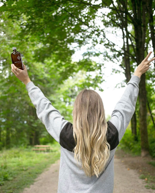 girl hiking with a bottle of healthy hooch
