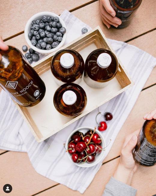 picnic with organic cherries, blueberries and healthy hooch kombucha
