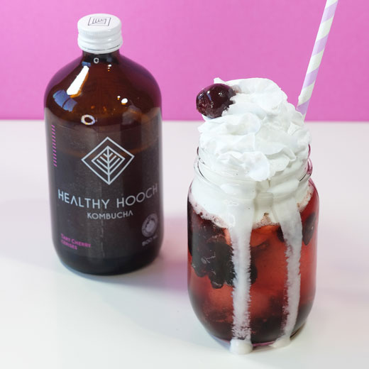cherry float next to a bottle of healthy hooch
